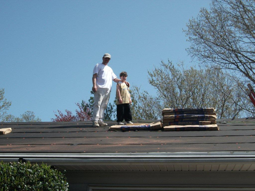 The Virginia Beach family (carefully supervised) inspects the work as it progresses