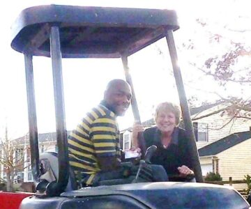 sheila and leon at concrete site on his tractor